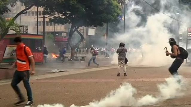 News video: Rocks and tear gas fly as Venezuela protests heat up